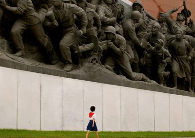 A-North-Korean-schoolgirl-walked-beside-a-military-sculpture-in-Pyongyang